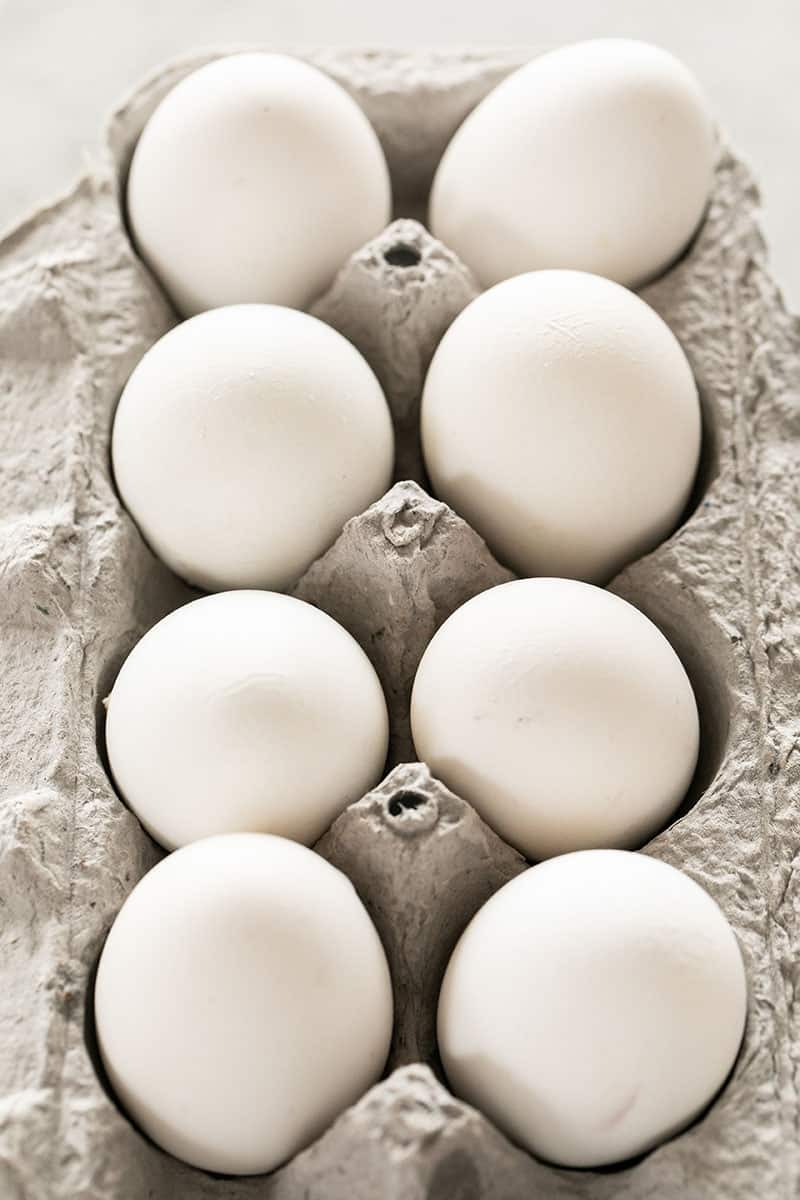 White eggs in a carton.