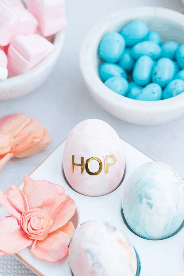 Colored Easter eggs with stickers that spell HOP