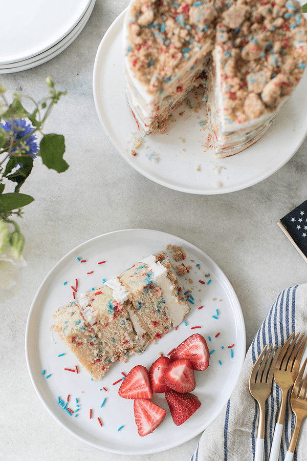 Layered funfetti cake with crumbles of cake and sprinkles
