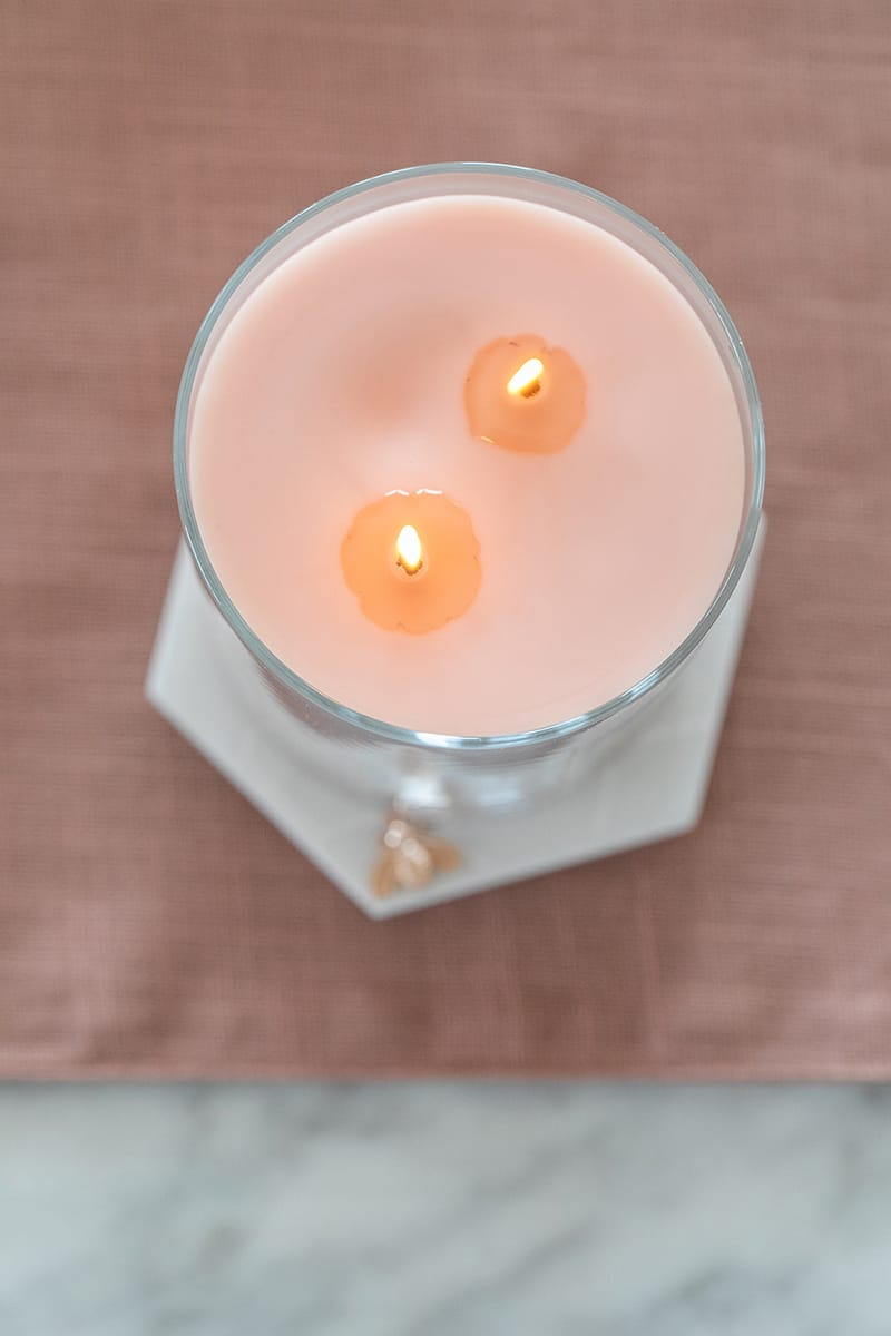 A pink lit candle