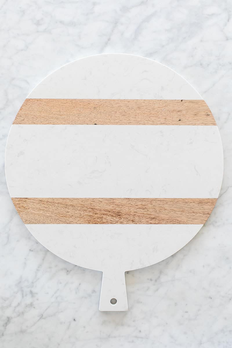 Large cheese platter with marble and wood.