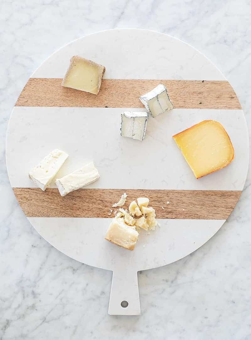 Placing cheese on a cheese platter.