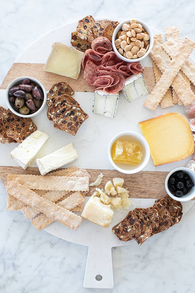 meat and cheese on a charcuterie board