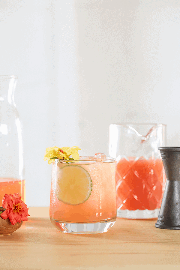 A classic Paloma with a lime slice and a flower.