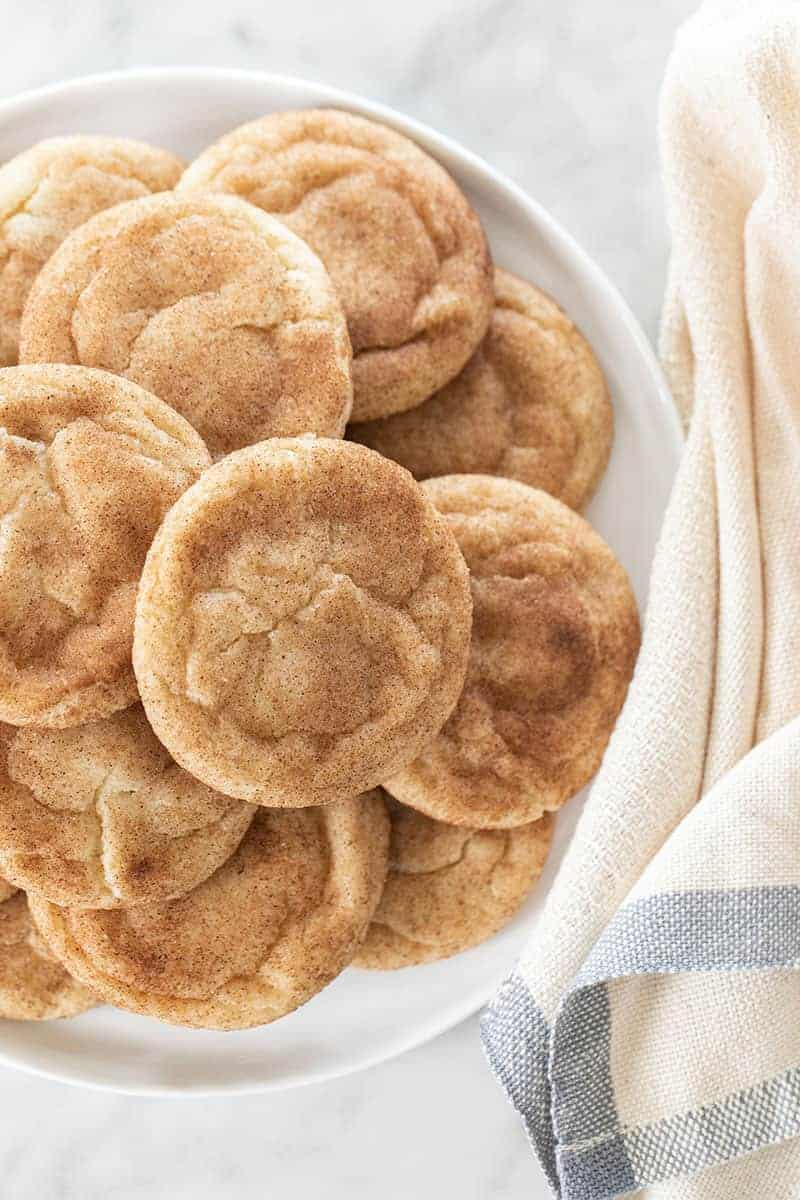 Homemade, chewy snickerdoodle cookies on a plate.