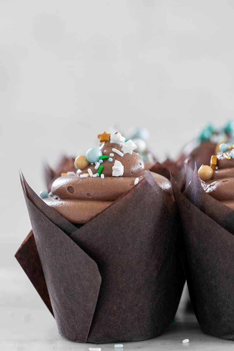 Chocolate cupcakes in brown tulip cupcake wrappers.