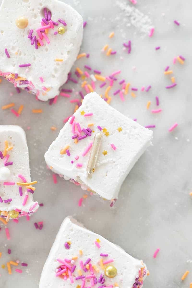 Marshmallow recipe with sprinkles on a marble table.