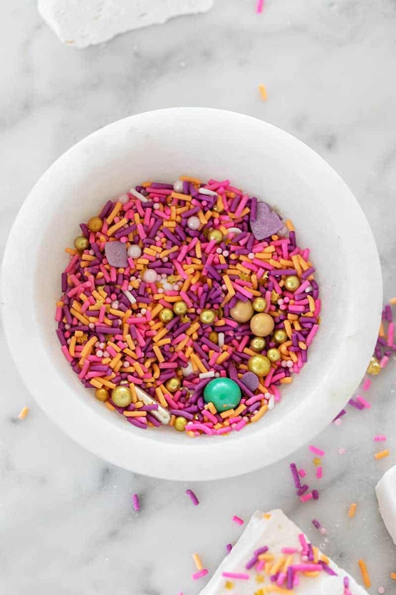 Bowl of pink sprinkles.