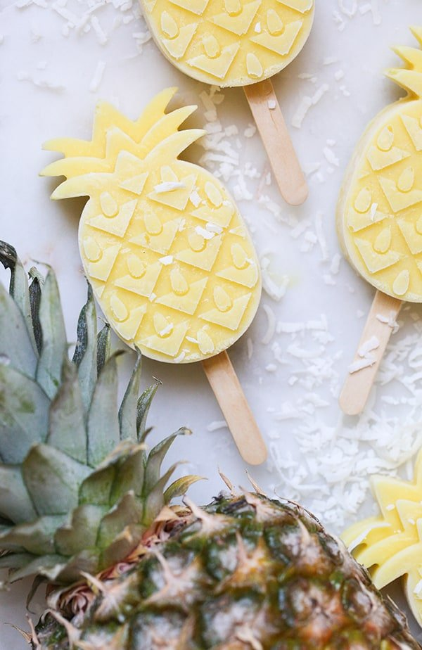 Pineapple popsicle in the shape of a pineapple.