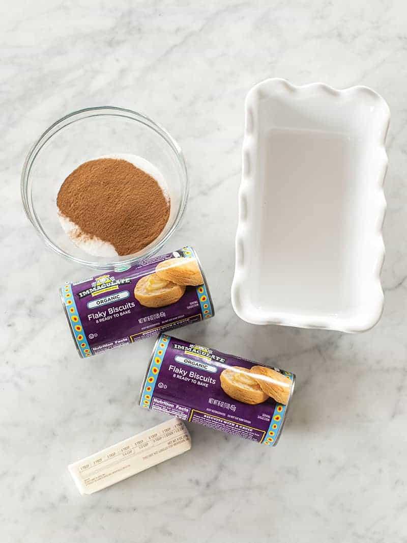 Loaf pan, biscuits, cinnamon and sugar.