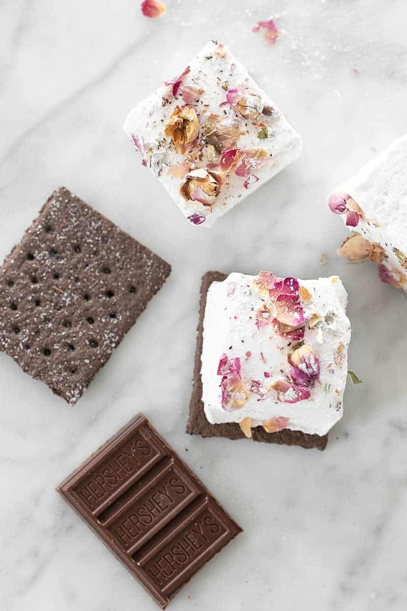 Rose flavored marshmallows on a Graham cracker and chocolate.