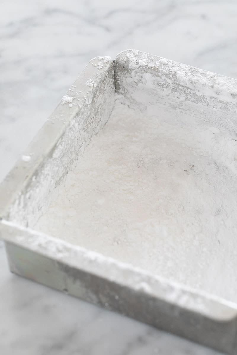 Baking dish with powdered sugar in it.