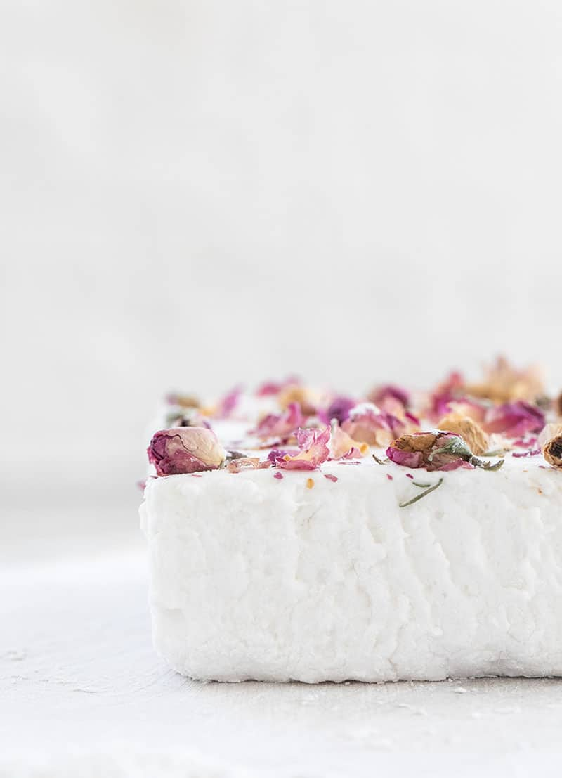 Homemade marshmallow sheet with dried rose petals over the top.