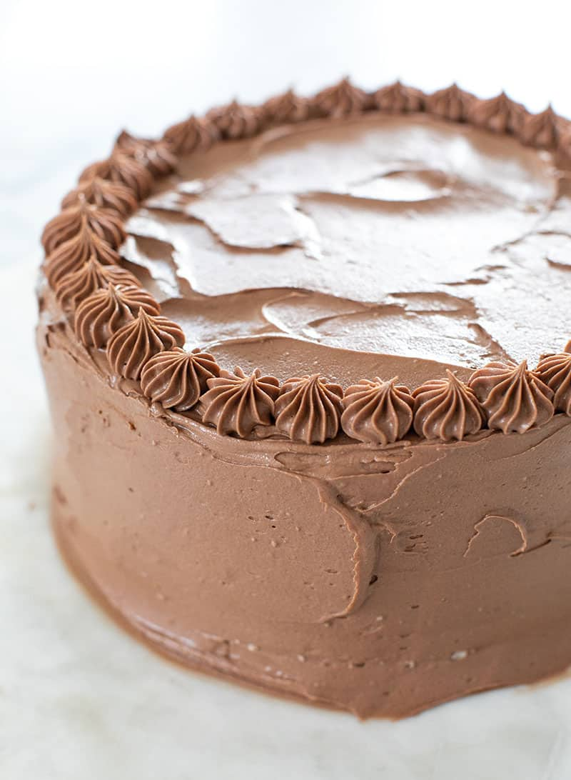 Birthday cake with chocolate frosting and a star tip.