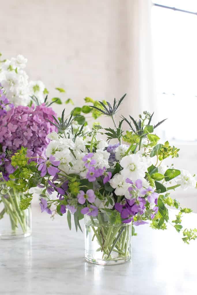 Flower arrangements in clear class jars.