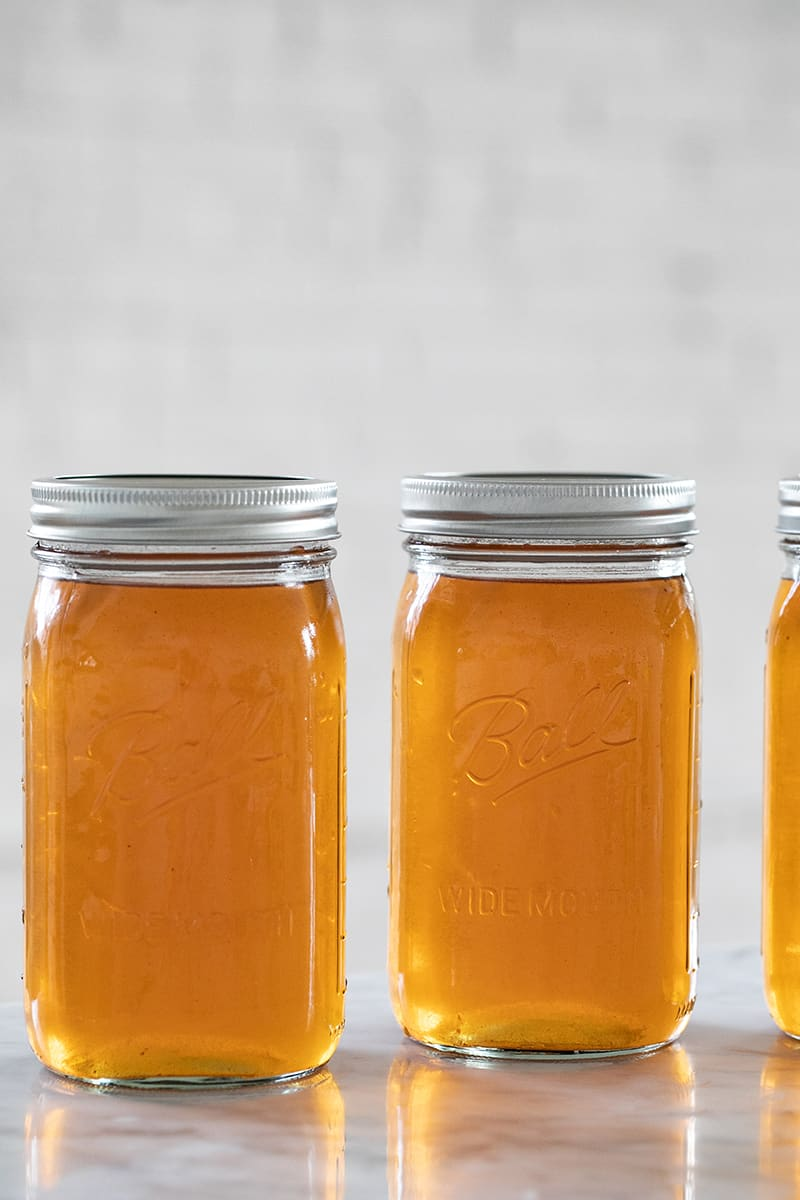 Apple pie moonshine in Ball jars with lids.