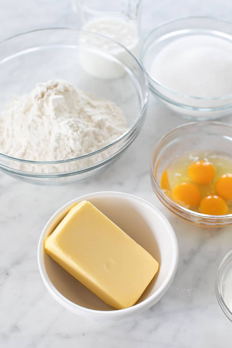 Butter, eggs and flour on a marble table.
