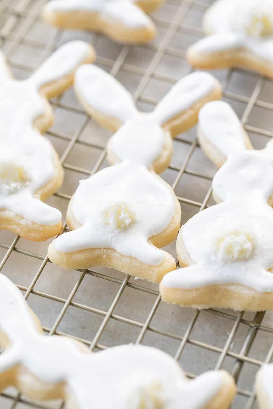 Bunny cookies with white royal icing recipe and little bunny tails.