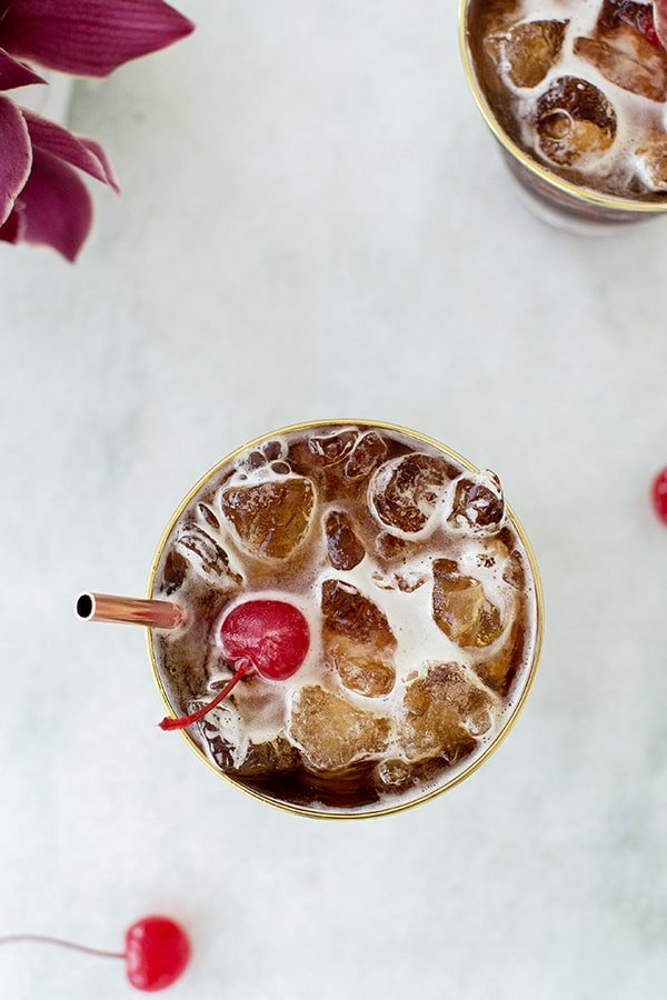 Coffee tonics with cherry and copper straw.