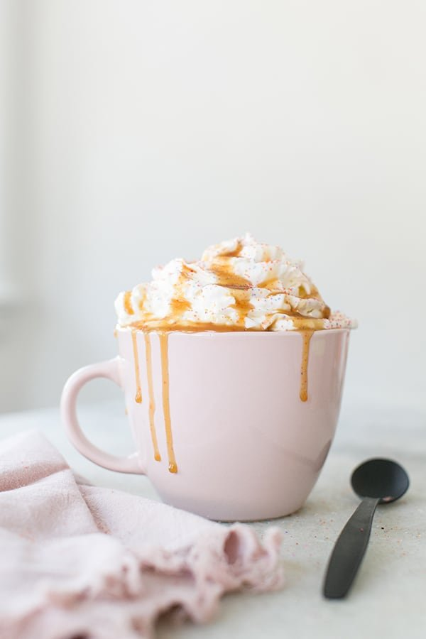 Creme Brûlée coffee drink with whipped cream, sprinkles and caramel sauce.