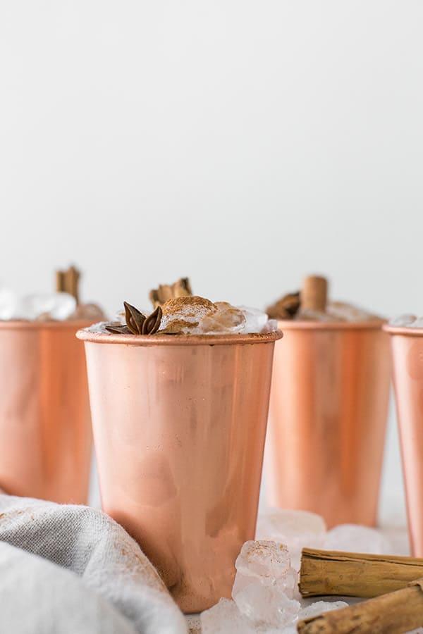 Cold brew chai tea lattes in copper mugs.