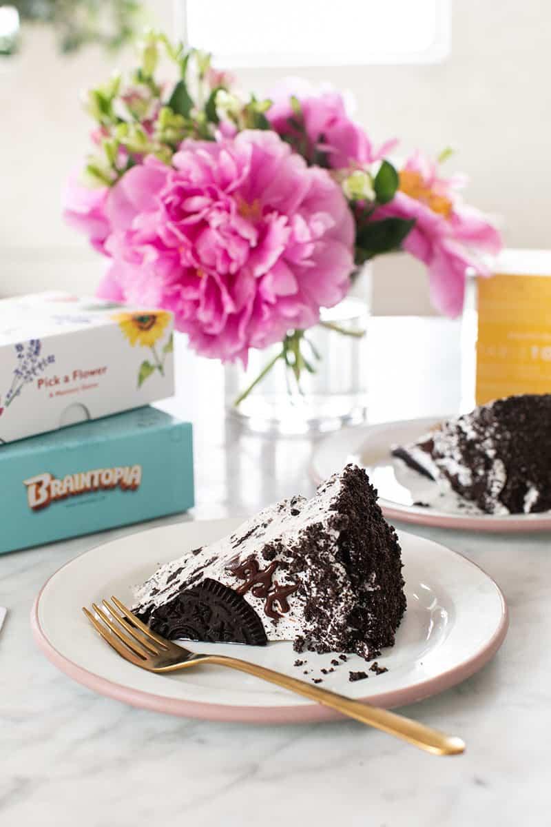 Slice of Oreo ice cream cake with Oreo crumbles.