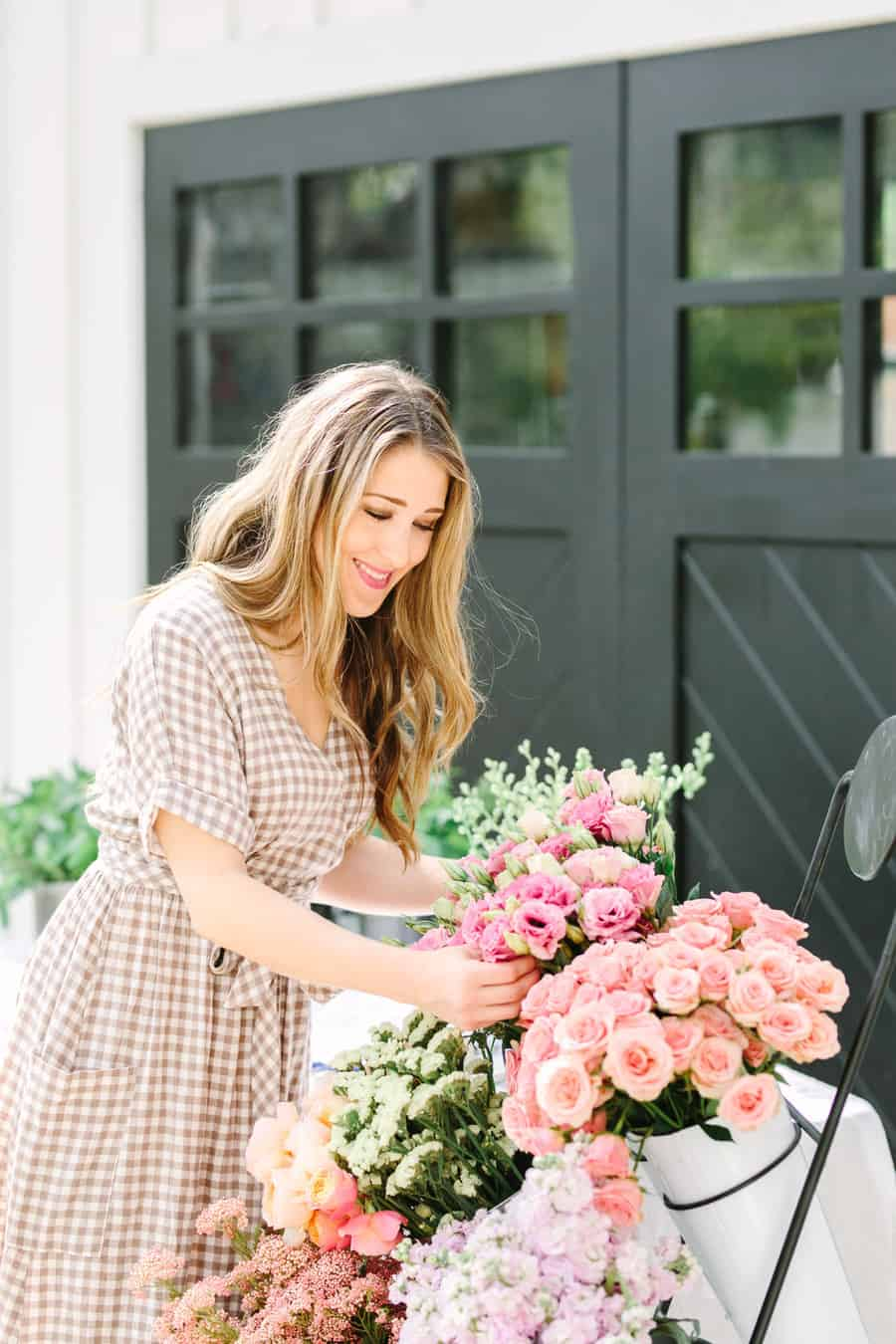 Eden Passante making a floral arrangement outside.
