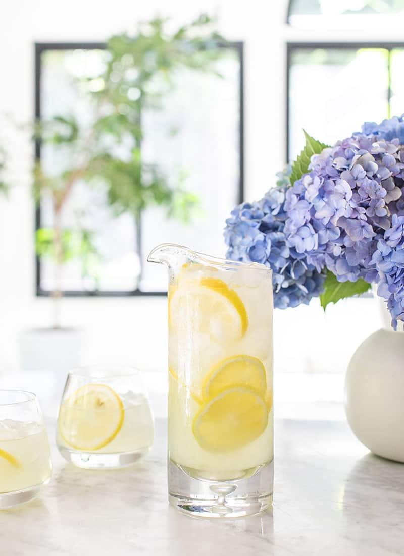 lemonade recipe with lemon juice for an easy homemade lemonade in a pitcher.