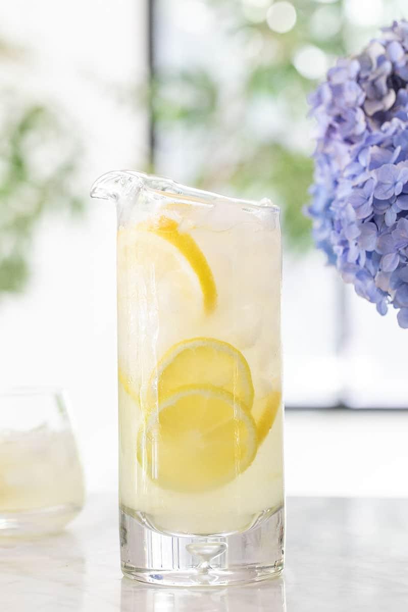Homemade lemonade in a pitcher with sliced lemons.