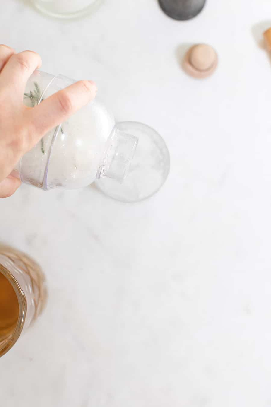 Pouring a mocktail into a glass.