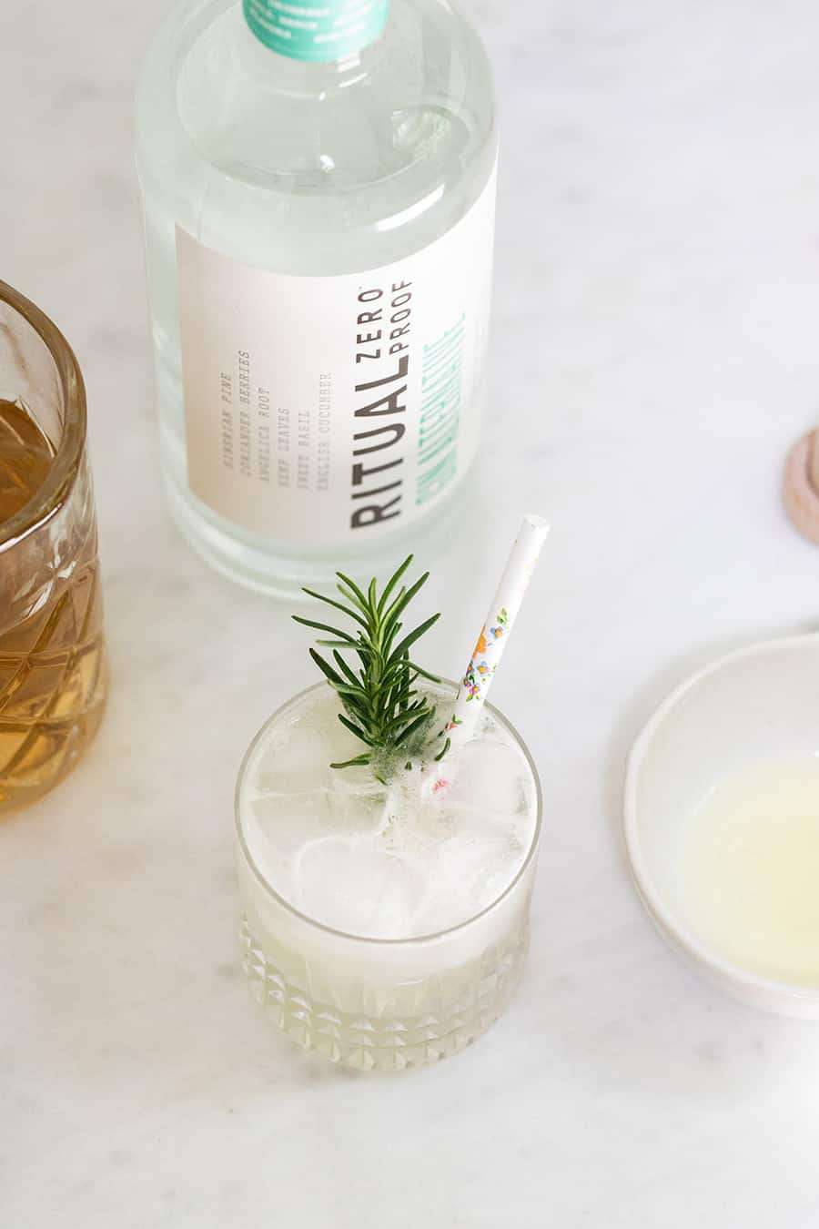 mocktail with rosemary, zero proof spirit and simple syrup.