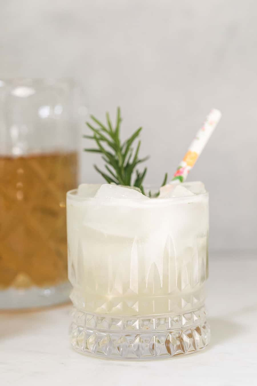 Mocktail recipe with rosemary and a straw