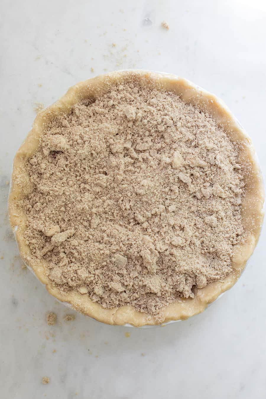 Uncooked pie with a crumble top.