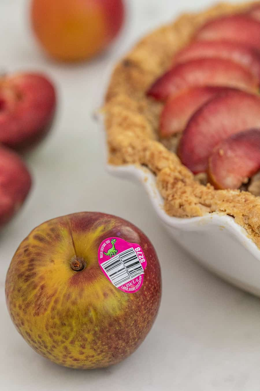 A plumcot with a pink label.