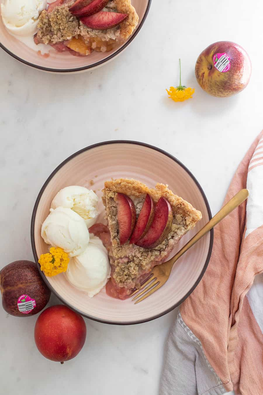 Slice of plumcot and aprium pie recipe.