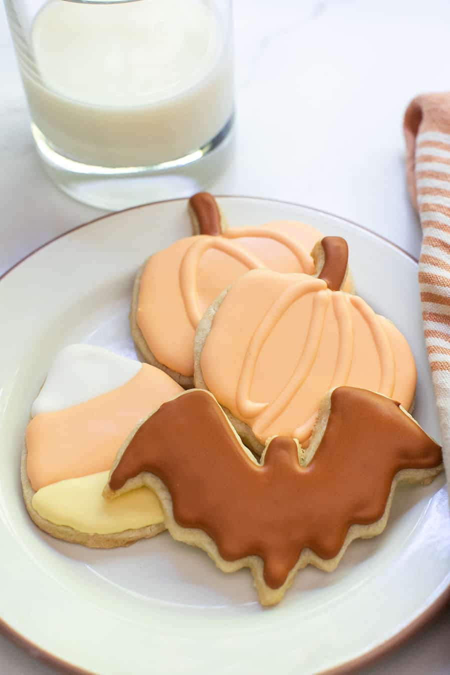 Plate filled with Halloween cookies.
