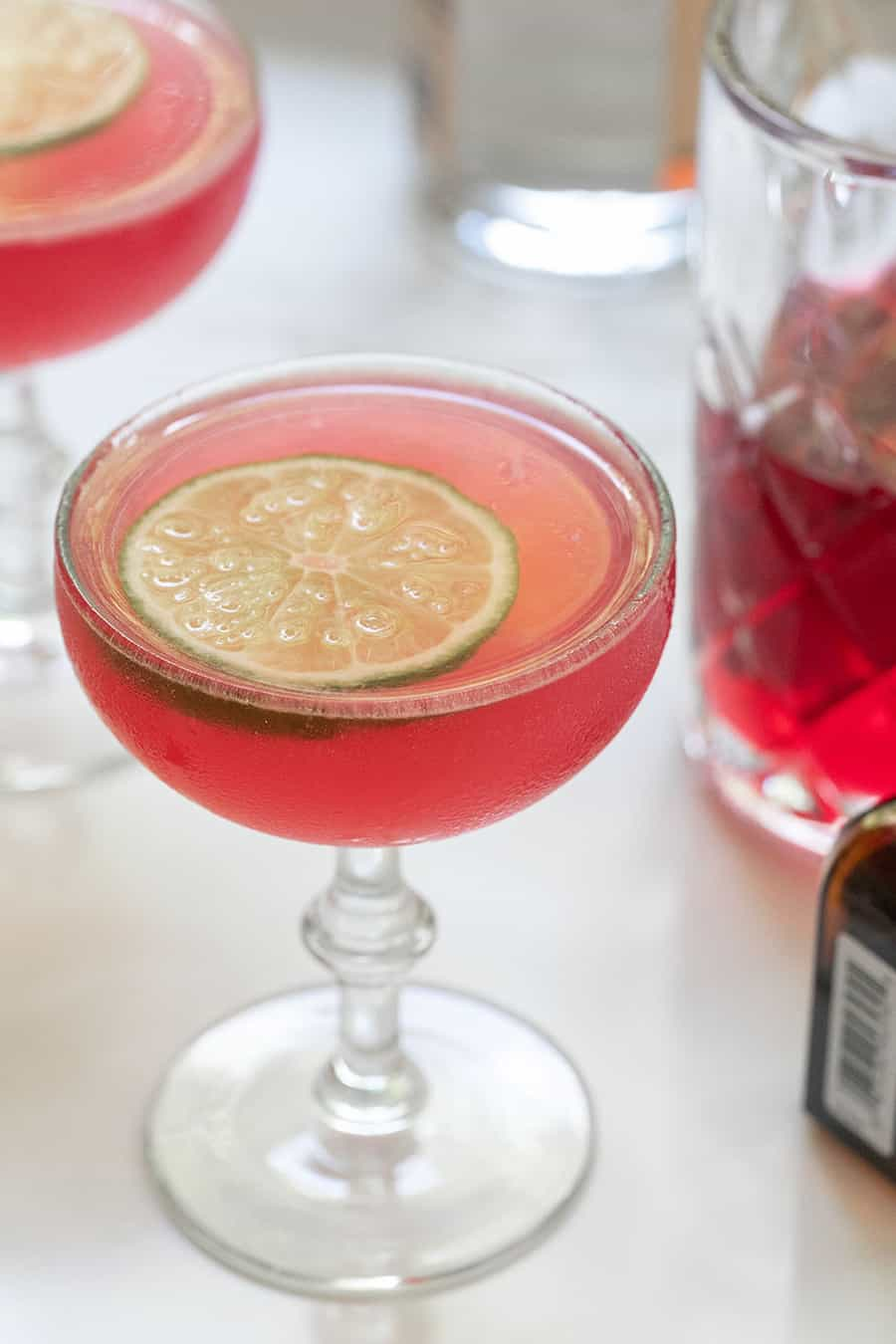 Pink cocktail with a lime wheel