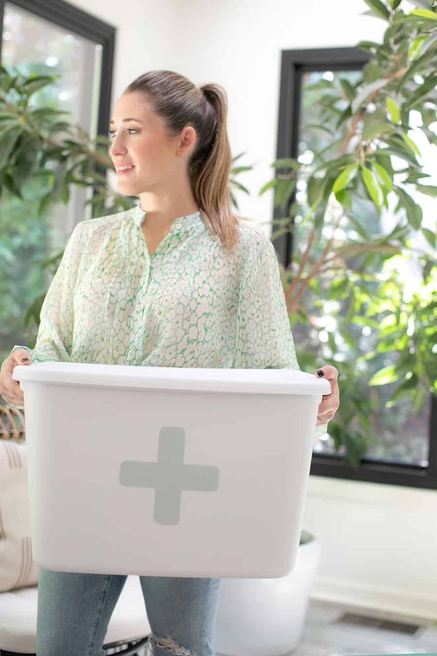 Eden Passante holding a bucket with a blue cross on it.