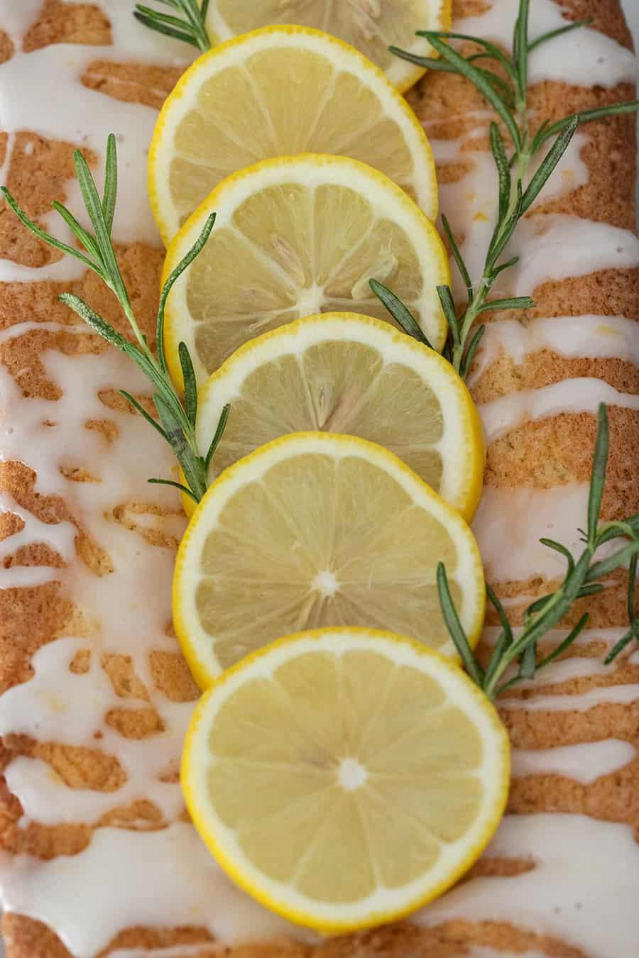 Sliced lemons on a loaf cake.
