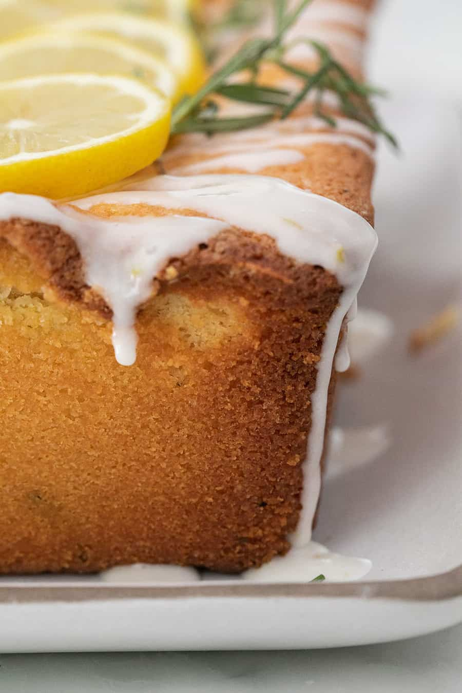 Lemon loaf cake with drizzled glaze over the top.