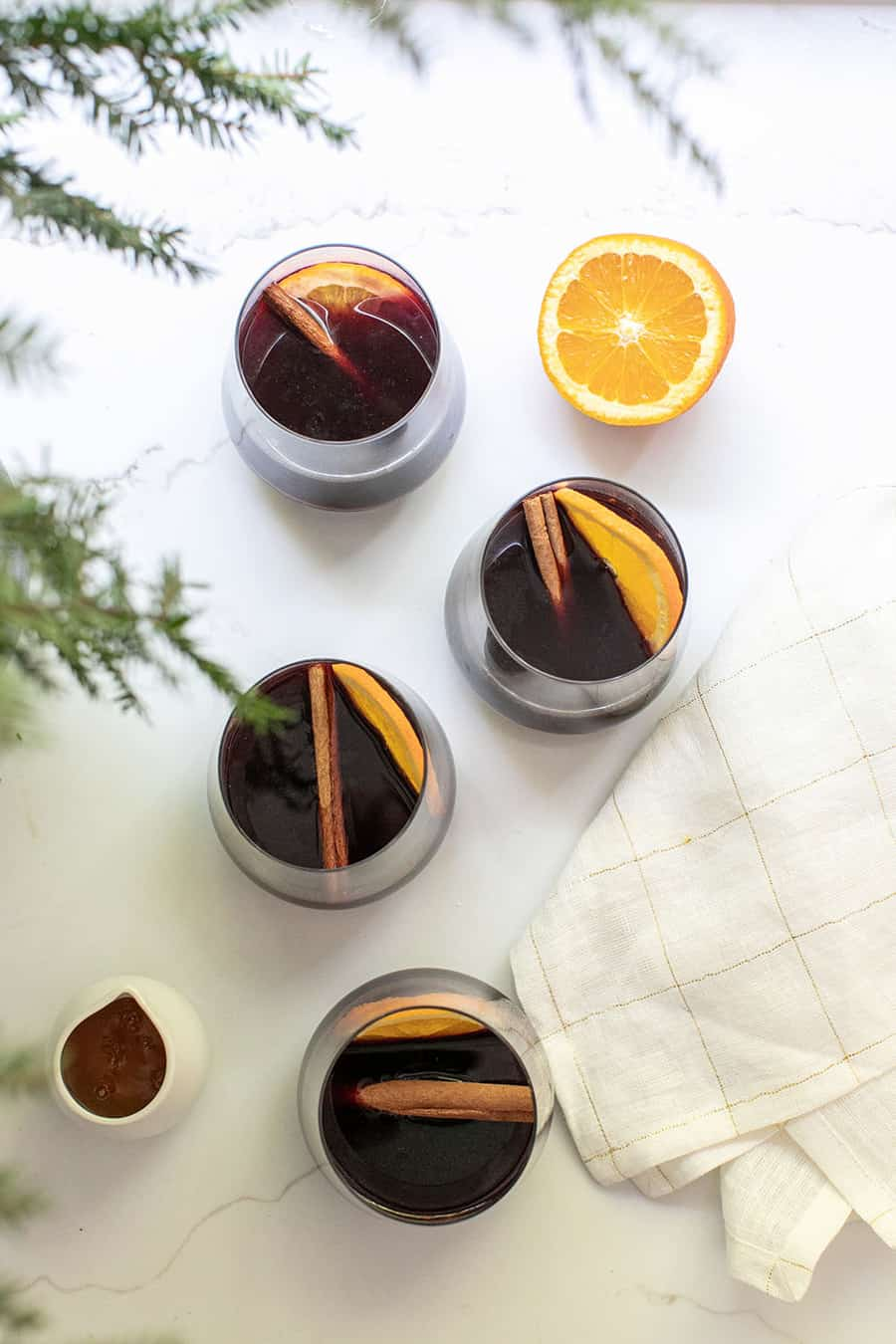mulled wine with orange slice and cinnamon