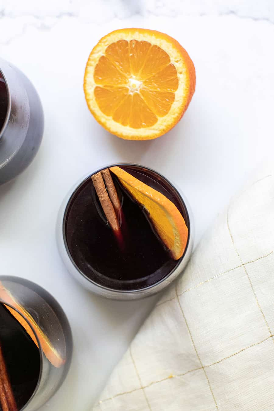 Mulled wine with cinnamon and orange slice