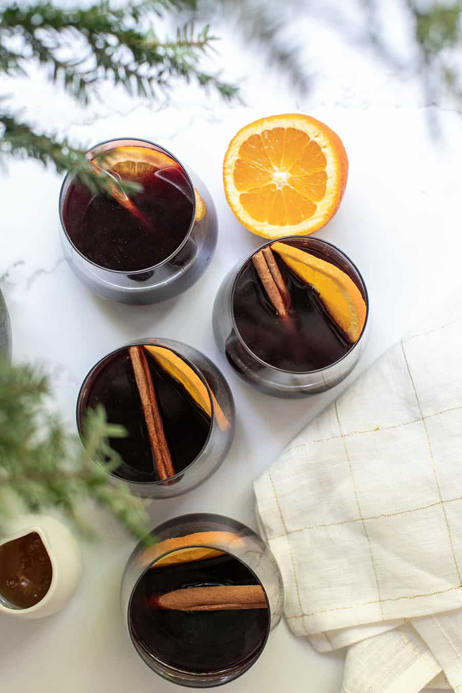 mulled wine recipe in glasses with orange class and cinnamon sticks