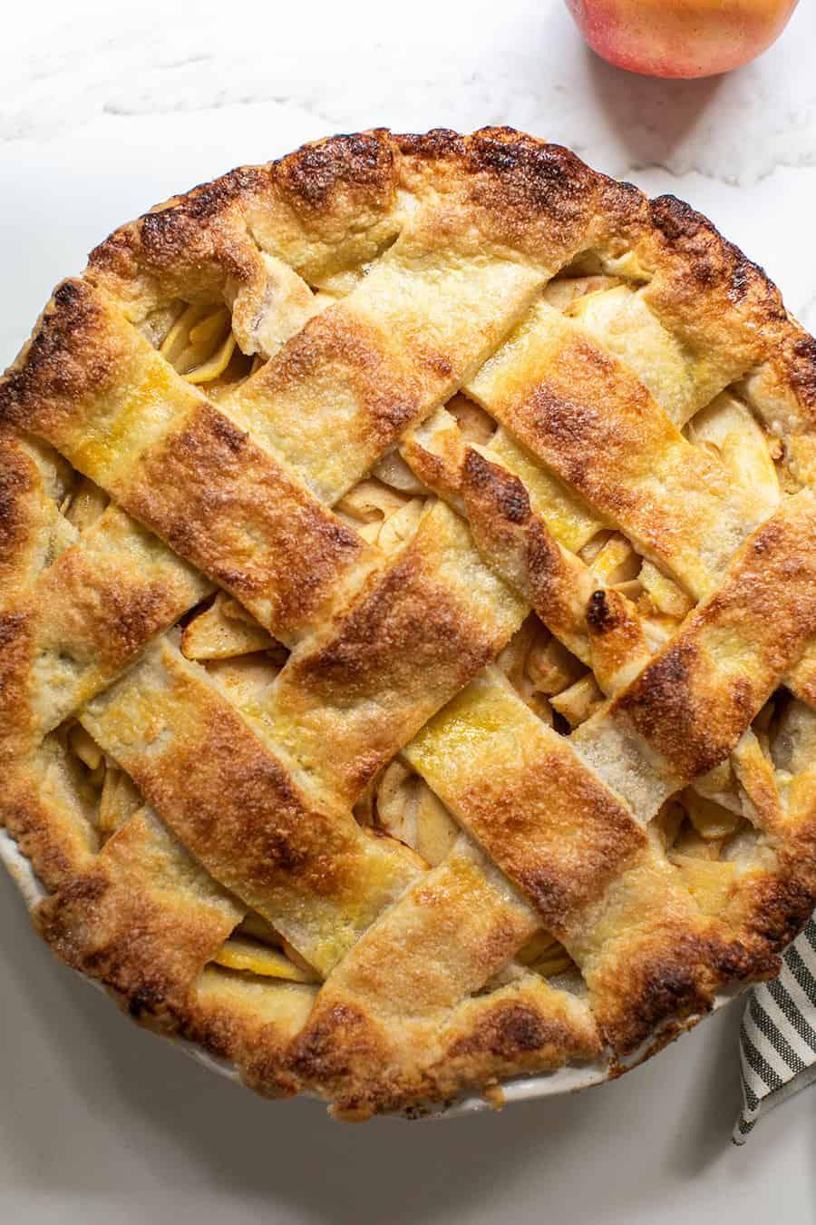 Homemade apple pie recipe with a golden brown pie crust top