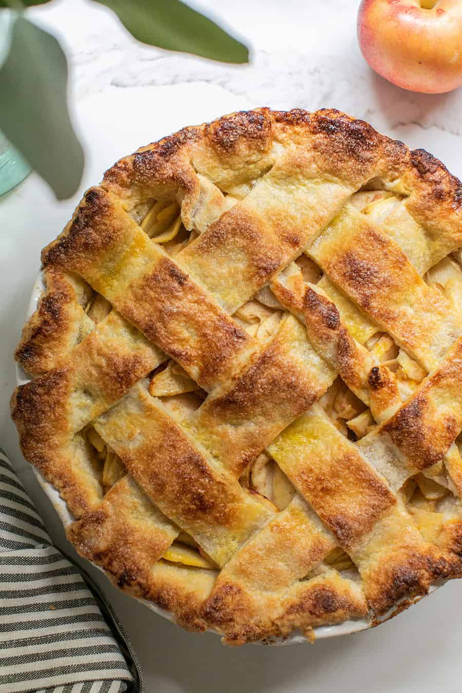 Close up of a golden brown homemade apple pie