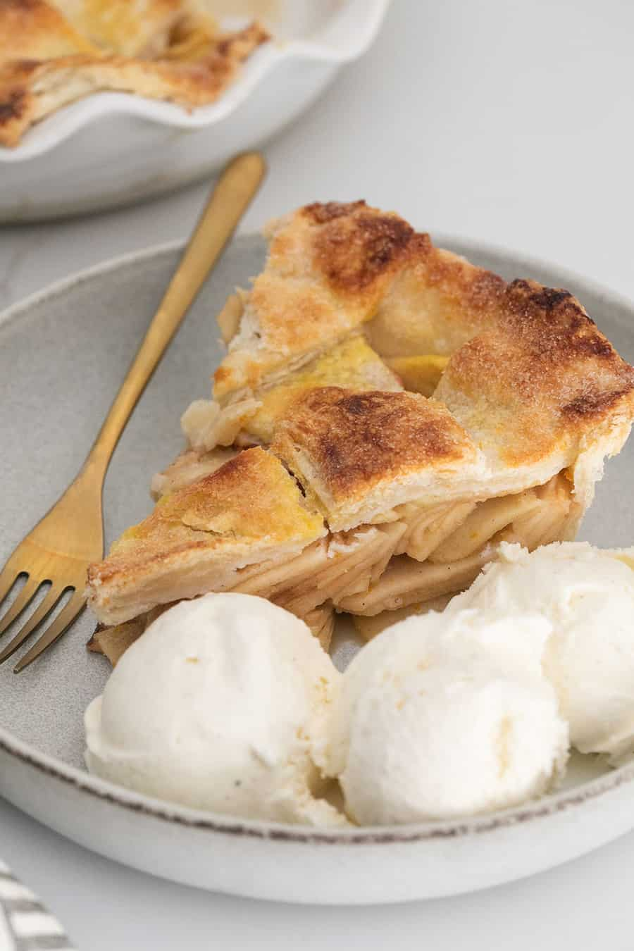 Ice cream and apple pie with thinly sliced apples