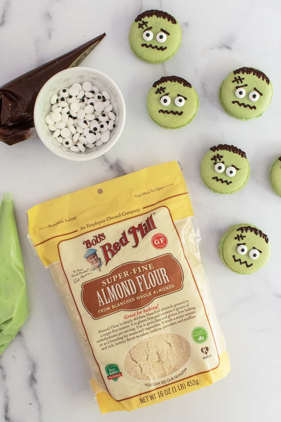 Bob's Red Mill Super Fine Almond Flour with eye sprinkles and green macarons