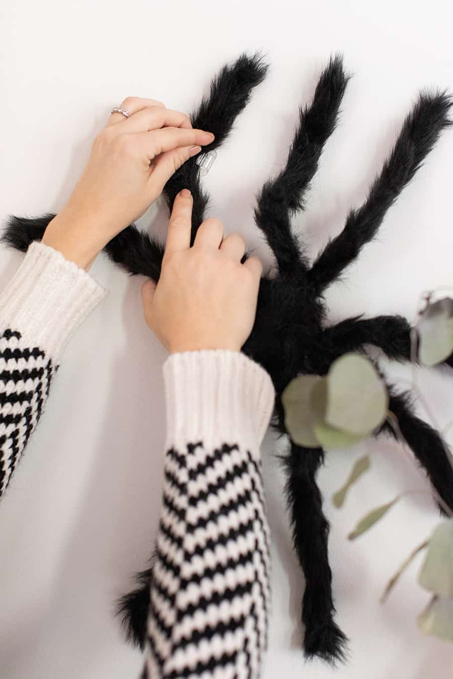Decorating the house with Halloween spiders