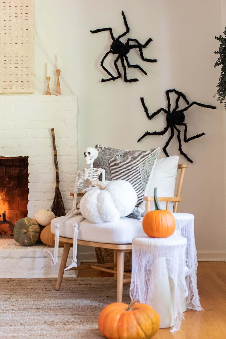 Halloween pumpkin, fireplace and skeleton