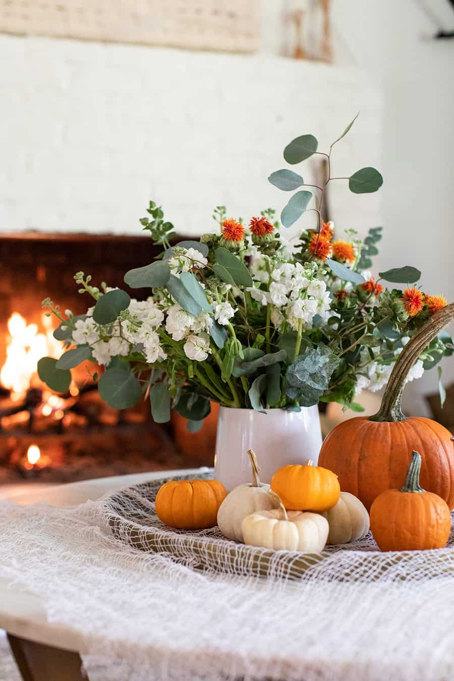 Halloween pumpkins and a vase wirth flowers